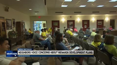 Community members voice their opposition to opening of Menards...